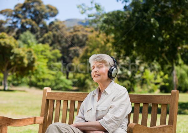 Elderly woman listening to some music Stock photo © wavebreak_media
