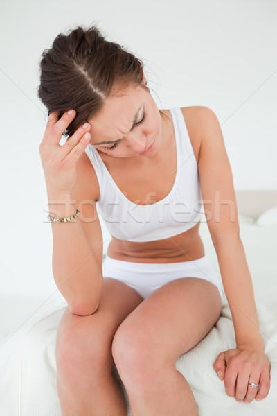 Jeune femme maux de tête blanche femme main visage Photo stock © wavebreak_media