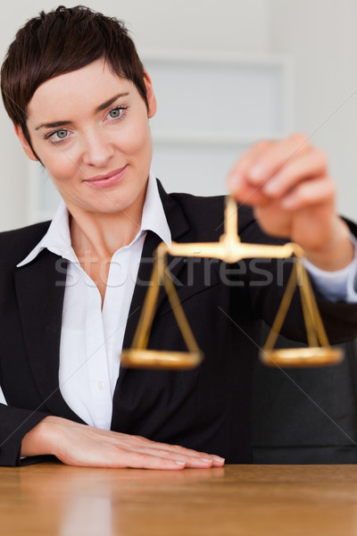 Woman holding the justice scale in her office Stock photo © wavebreak_media