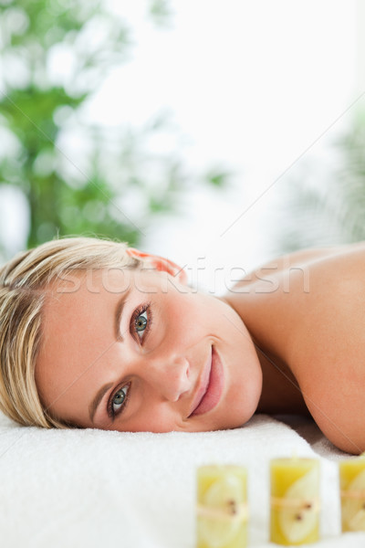 Blonde smiling woman relaxing on massage lounger in a wellness center Stock photo © wavebreak_media