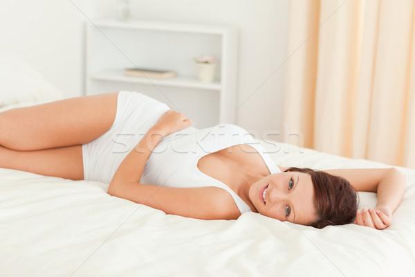 великолепный женщину расслабляющая кровать спальня Сток-фото © wavebreak_media