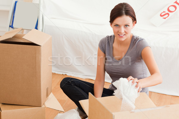 Young woman clearing out looking into the camera in her former home Stock photo © wavebreak_media