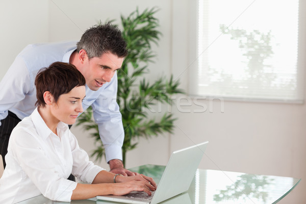 Manager and his secretary working with a laptop in an office Stock photo © wavebreak_media