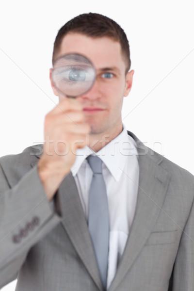 портрет бизнесмен глядя увеличительное стекло белый стороны Сток-фото © wavebreak_media