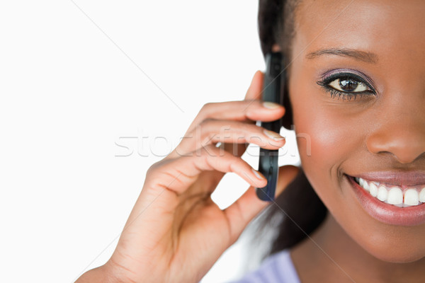 Close up of smiling woman on her phone against a white background Stock photo © wavebreak_media