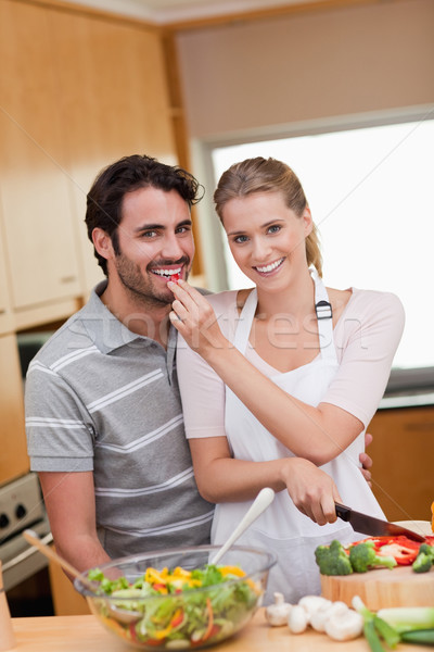 Portrait of a charming couple cooking in their kitchen Stock photo © wavebreak_media