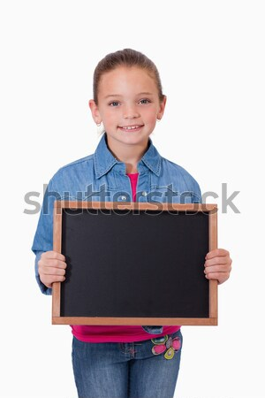 Portrait of a young girl holding a school slate against a white background Stock photo © wavebreak_media