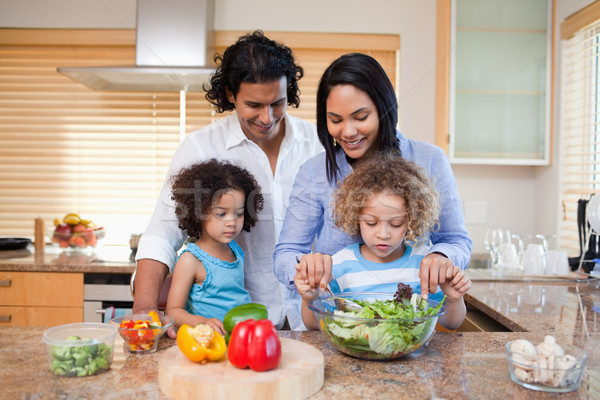 Young family preparing salad together in the kitchen Stock photo © wavebreak_media