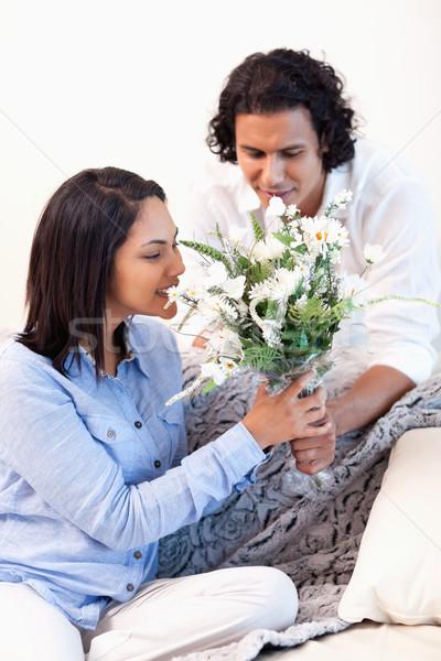 Young boyfriend getting a bouquet by her boyfriend Stock photo © wavebreak_media