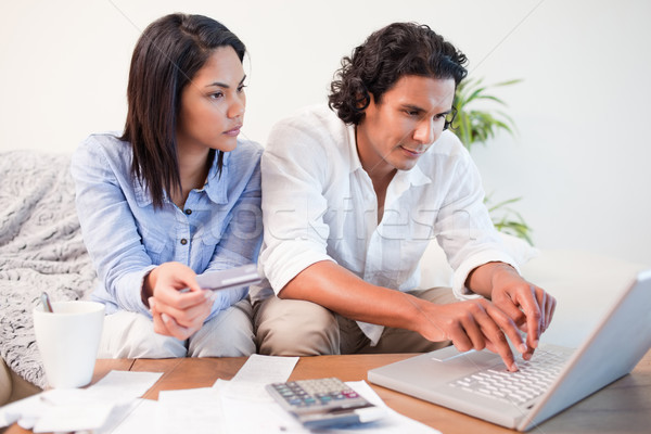 Young couple checking their bank accounts online Stock photo © wavebreak_media