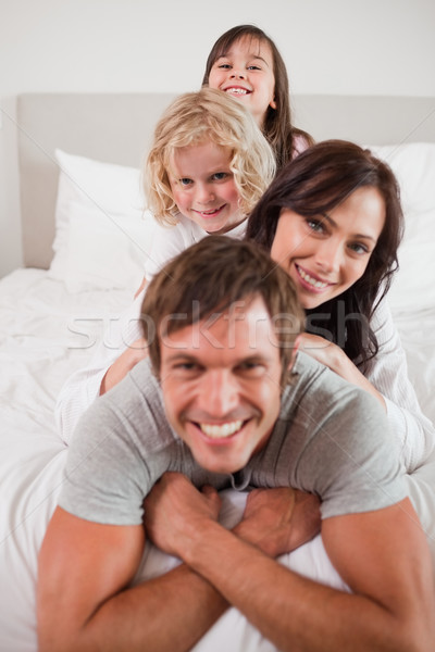 Portré boldog család egyéb hálószoba arc szeretet Stock fotó © wavebreak_media