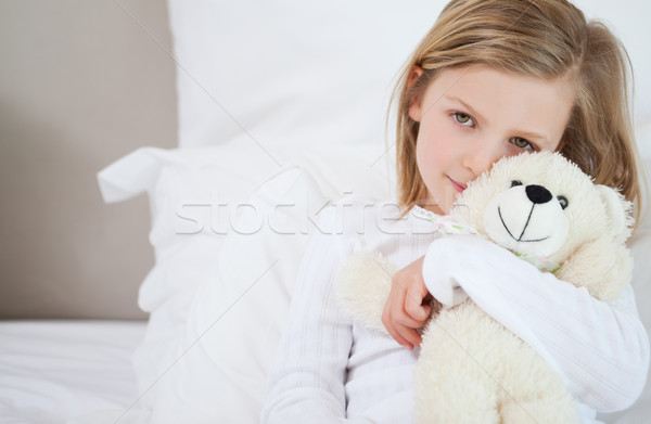 Little girl with her teddy sitting on the bed Stock photo © wavebreak_media