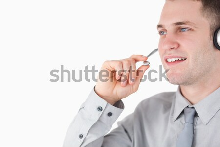 Glimlachende vrouw microfoon witte achtergrond mooie zingen Stockfoto © wavebreak_media