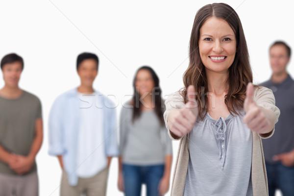 Donna sorridente amici dietro bianco felice Foto d'archivio © wavebreak_media