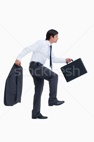 Side view of walking tradesman with suitcase and jacket against a white background Stock photo © wavebreak_media