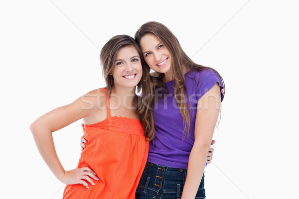 Teenagers holding each other by the waist while smiling Stock photo © wavebreak_media