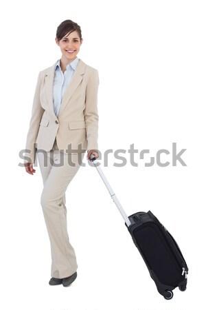 деловая женщина ходьбе вперед чемодан бизнеса моде Сток-фото © wavebreak_media