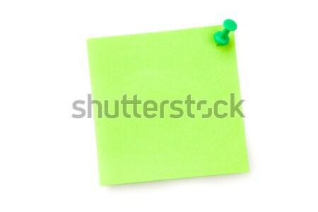 Green adhesive note against a white background Stock photo © wavebreak_media