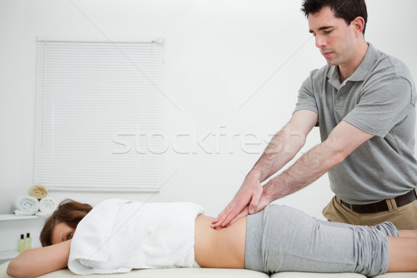 Man standing while massaging the back of a woman in a room Stock photo © wavebreak_media