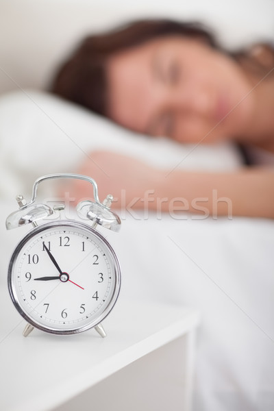 Alarm clock being placed on a bedside table in a bedroom Stock photo © wavebreak_media