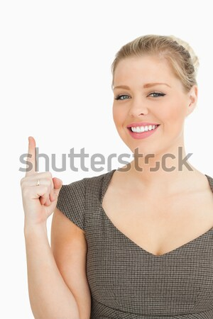 Woman smiling showing something against white background Stock photo © wavebreak_media