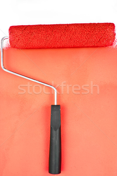 Red brush stroke with paint roller in a studio Stock photo © wavebreak_media