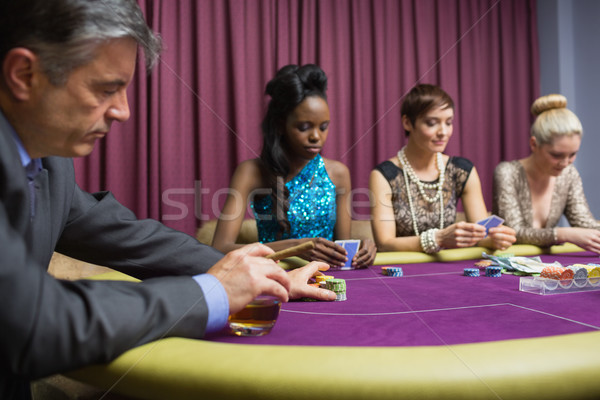 Man with whiskey placing bet in casino Stock photo © wavebreak_media