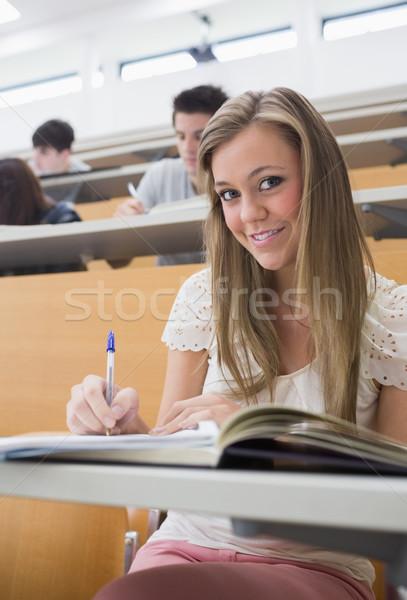 Kadın oturma ders salon kalem Stok fotoğraf © wavebreak_media