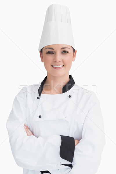 Smiling and standing cook wearing a chef hat in front of camera Stock photo © wavebreak_media