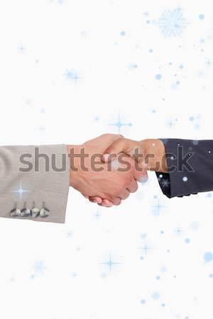 Handcuffed business people shaking hands Stock photo © wavebreak_media