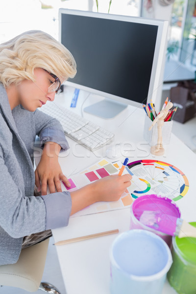 Concentrated interior designer looking at colour charts Stock photo © wavebreak_media