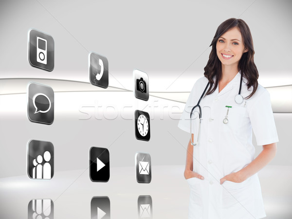 Composite image of confident and smiling woman doctor standing i Stock photo © wavebreak_media