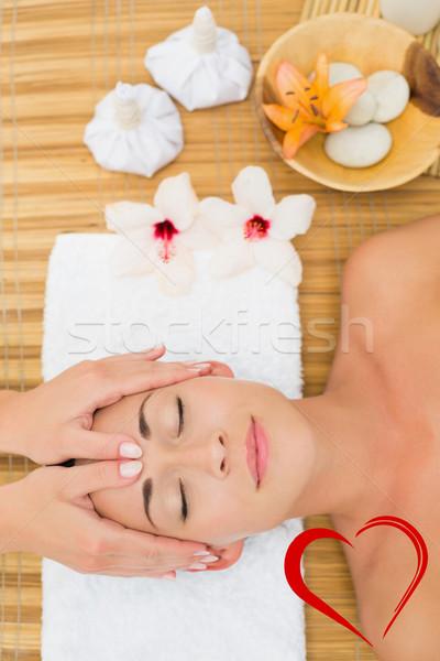 Composite image of smiling brunette enjoying a head massage Stock photo © wavebreak_media