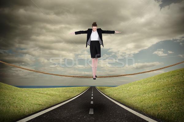 összetett kép üzletasszony előad egyensúlyoz tett Stock fotó © wavebreak_media
