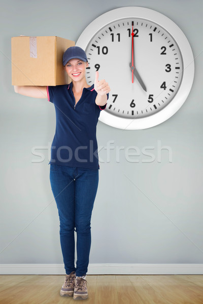 Composite image of happy delivery woman holding cardboard box Stock photo © wavebreak_media