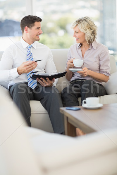 Businessman and his secretary with diary and tea cup Stock photo © wavebreak_media