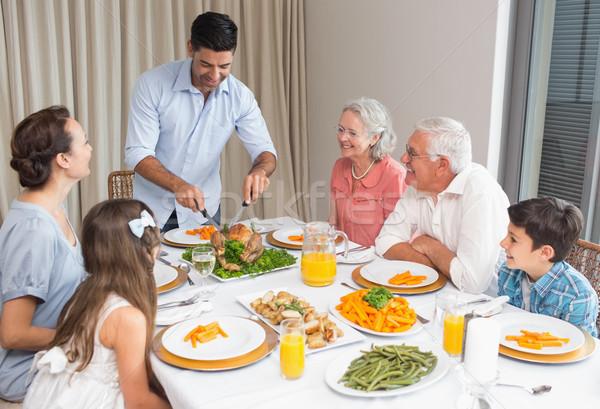 Família grande mesa de jantar casa sessão família comida Foto stock © wavebreak_media