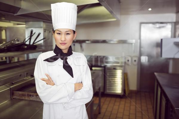 Portrait of confident female cook in kitchen Stock photo © wavebreak_media