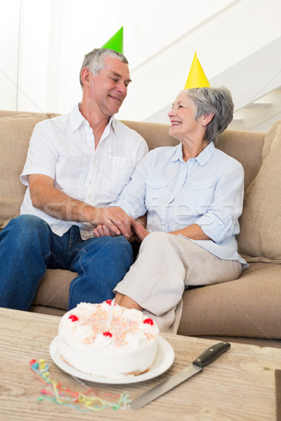 Senior couple sitting on couch celebrating a birthday Stock photo © wavebreak_media