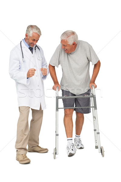 Doctor with senior man using walker Stock photo © wavebreak_media