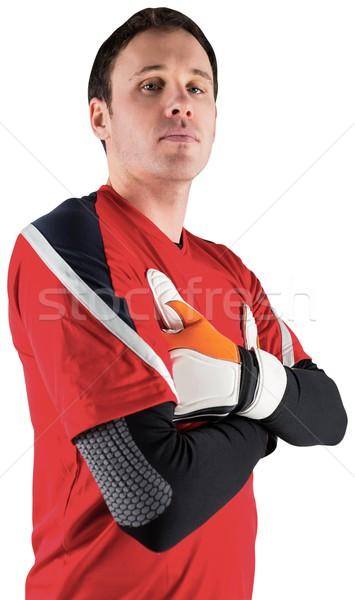 Goalkeeper in red looking at camera Stock photo © wavebreak_media