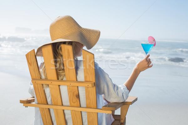 Donna rilassante deck sedia mare Foto d'archivio © wavebreak_media