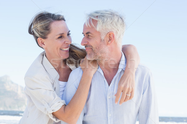 Attractive married couple hugging at the beach Stock photo © wavebreak_media
