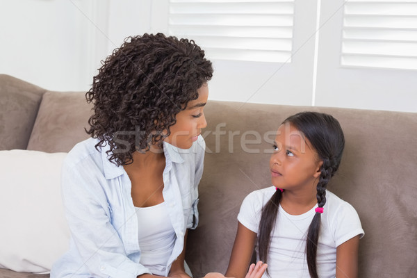 Pretty mother sitting on the couch scolding her daughter Stock photo © wavebreak_media