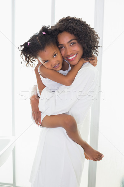Pretty mother picking up her daughter and hugging her Stock photo © wavebreak_media