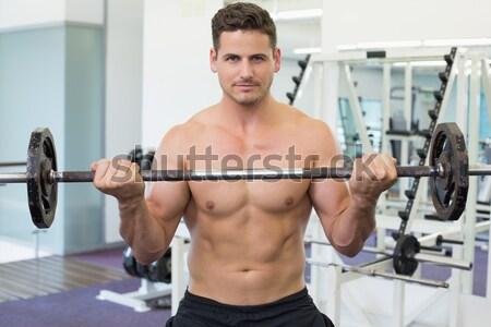 A torso nudo muscolare uomo manubri Foto d'archivio © wavebreak_media