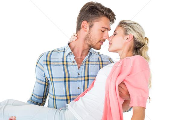 Handsome man picking up and hugging his girlfriend Stock photo © wavebreak_media