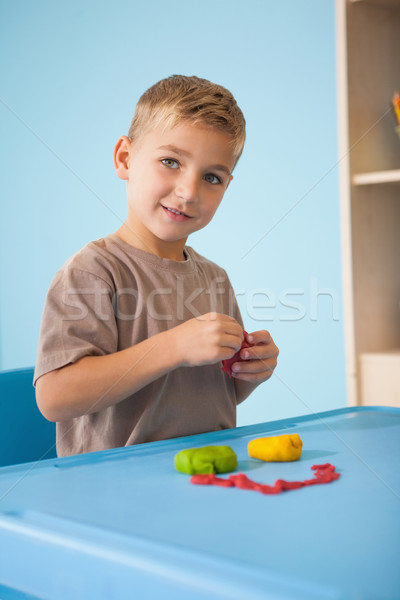 Cute little boy playing with modelling clay in classroom Stock photo © wavebreak_media