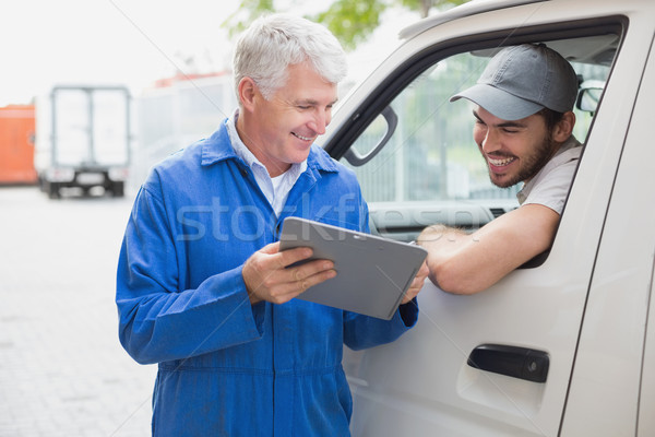 Delivery driver smiling at camera with customer Stock photo © wavebreak_media