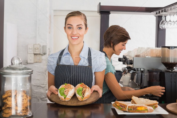 Pretty waitresses working with a smile Stock photo © wavebreak_media
